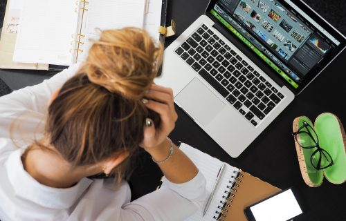 Woman Stressed Out At Desk